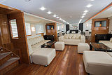 Interior of large salon area of luxury motor yacht