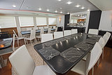 Interior of large salon dining area of luxury motor yacht