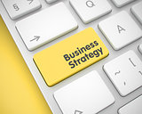 Business Strategy - Text on the Yellow Keyboard Key. 3D.