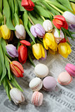 Colorful macaroons and tulips