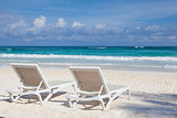 Two white beach chairs on the empty beach , Yucatan, Mexico