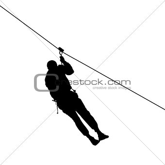 Black silhouette extreme rope descent attraction, man descends down the cable car