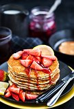 Stack of freshly prepared lemon poppy seed  pancakes with fresh