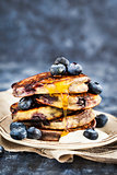 Stack of freshly prepared blueberry ricotta pancakes with fresh
