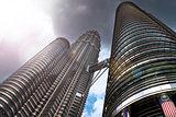 The Petronas Twin Towers in Kuala Lumpur, Malaysia, in a dramati