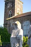 faceless monk statues outside church