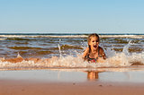 Little girl playing on the Brackley beach