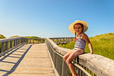 Little girl having fun on boardwalk to Brackley Beach