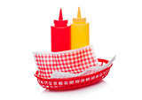 Hot dog fast food basket with ketchup and mustard