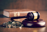 judge gavel and handcuffs