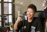 Laughing Woman with a Phone in Her Office