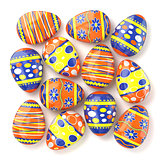 Easter eggs with colorful patterns lying on white background. 3D
