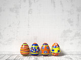 Easter eggs painted on white wooden background. Easter concept.