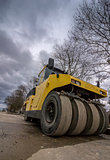 Close view on the road roller. Street paving works. Wide angle