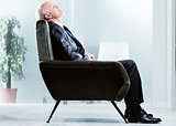 Tired businessman taking a moment to relax