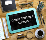 Courts And Legal Services - Text on Small Chalkboard. 3d