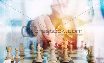 Business strategy with chess game and handshaking business person in office. concept of challenge and tactic. double exposure