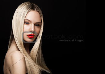 Beauty portrait model with shiny blonde hairstyle