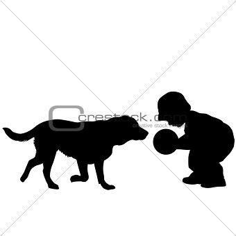 Toddler playing with a dog