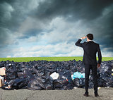 Businessman searches far for clean environment. overcome the global pollution problem