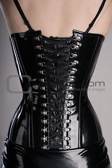 Back view of sexy woman in black corset