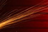 Angle grinder sparks on red background