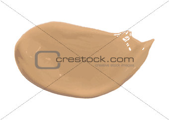 Smear of foundation lotion made with brush on white background.