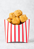 Paper container with fried crispy chicken popcorn