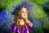Little girl on lavender field. Portrait of a little girl in wreath of flowers