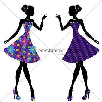 Slim stylish girls in short dresses