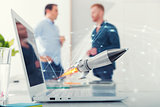 Businessperson in office work for a startup of a company with a rocket