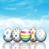 Easter eggs on a blue sky background