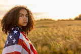 Sad Depressed Girl Woman Teenager Wrapped in USA Flag at Sunset