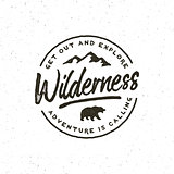 vintage wilderness logo. hand drawn retro styled outdoor adventure emblem. vector illustration