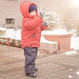 Boy smiles cheerfully while snows