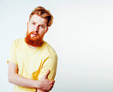young handsome hipster ginger bearded guy looking brutal isolate