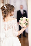 portrait of the bride. Groom is blurred