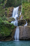Scenic waterfalls and lush vegetation in Jamaica