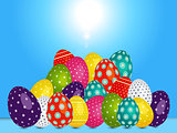 Loads of decorated Easter eggs over blue sunny sky