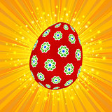 Red decorated Easter egg on yellow background