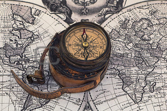 Ancient compass on the world map.