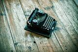Vintage typewriter hero header on wooden desk