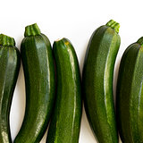 Zucchini (zucchetti, courgettes) on a white background