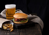 Fresh beef burger with potato wedges and beer