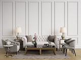 Classic interior.Sofa,chairs,sidetables with lamps,table with decor.White walls with mouldings