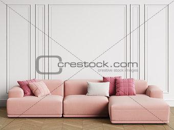 Modern Scandinavian Design sofa in interior. Walls with moldings,floor parquet herringbone.Copy space,mockup interior