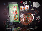 Online casino concept. Mobile phone, roulette with casino chips,