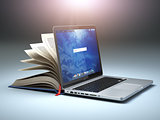 Online library or E-learning concept. Open laptop and book compi