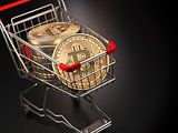 Bitcoin BTC coins in the shopping cart on black background. Cryp