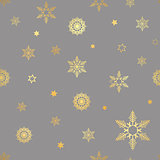 luxury seamless pattern with gold snowflakes on a dark background